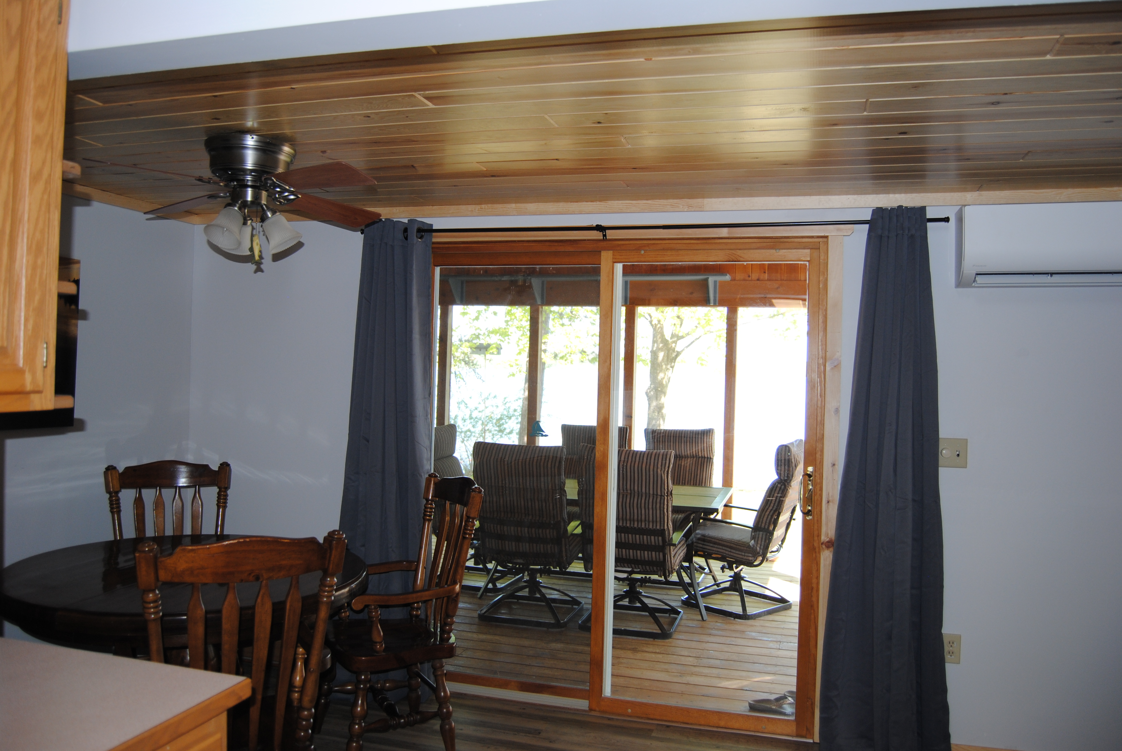 Birchwood Cabin dining tables, indoor and on patio.