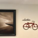 Aspen Cabin framed photo and metal bicycle art.