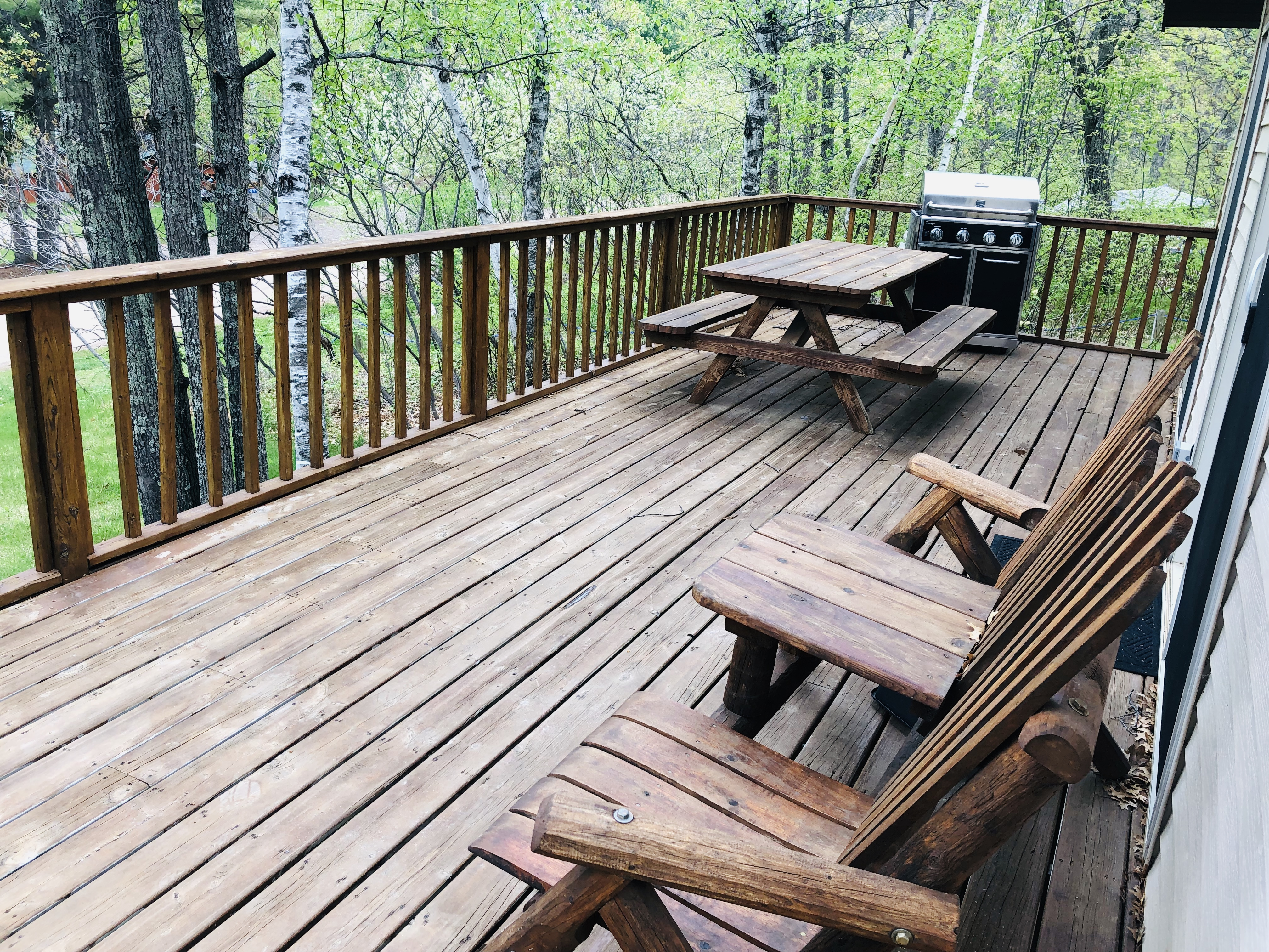 Virginian Pine patio with picnic table, Adirondack chairs and gas grill.