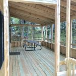 Aspen Cabin covered patio with picnic table.